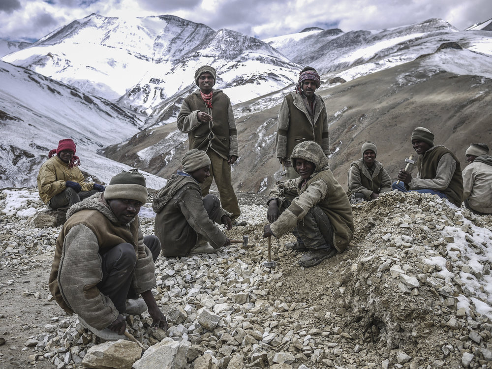Bihari Migrant workers crush rocks on a portion of the highway connecting the regional capital, Leh, with the Changtang Plateau.