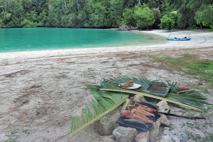 lunch on an island in raja ampat while sailing with tiger blue