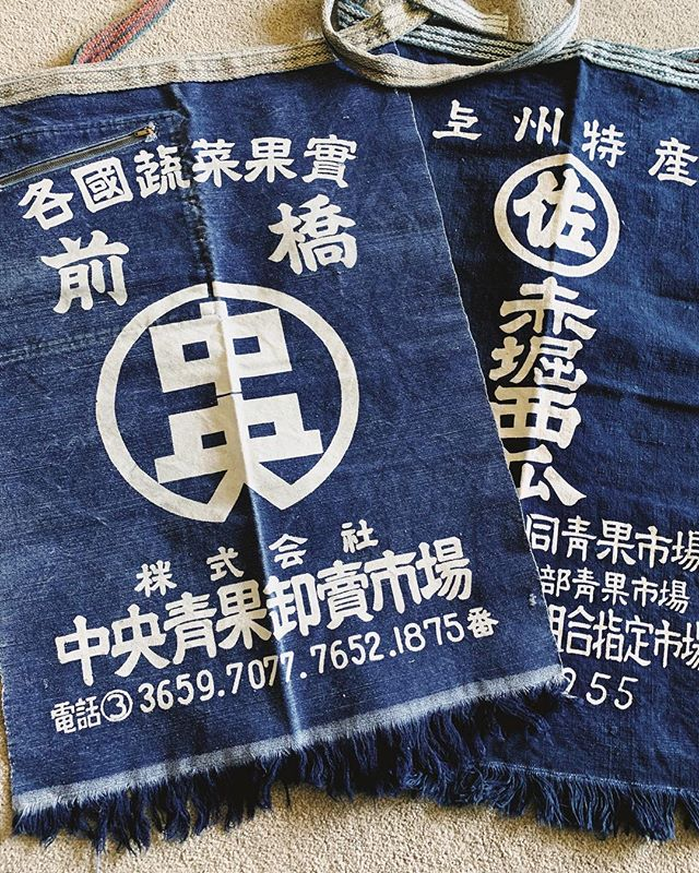 Long Japanese Maekake worker's apron. Indigo blue with white lettering, thickly woven