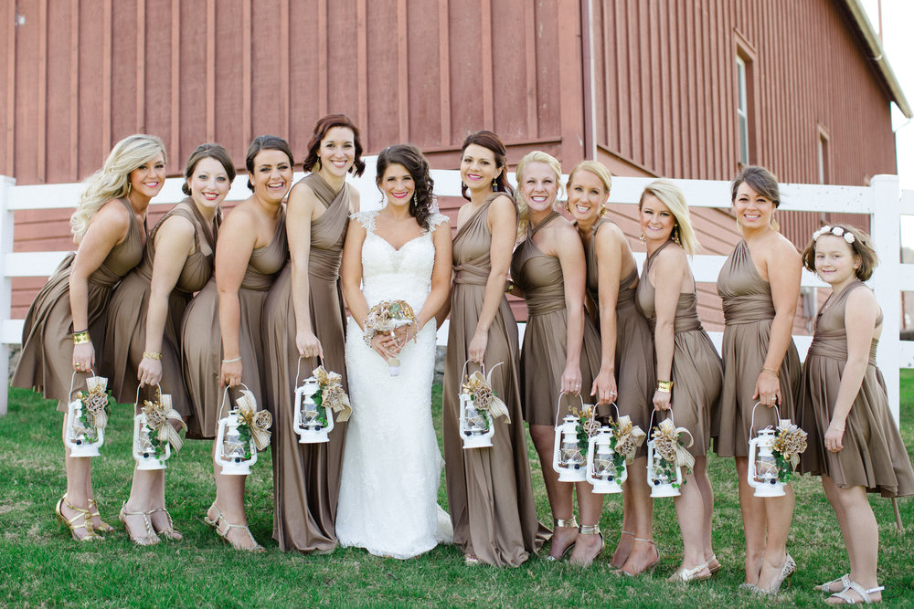 Bridesmaids at Friedman Farms carrying lanterns