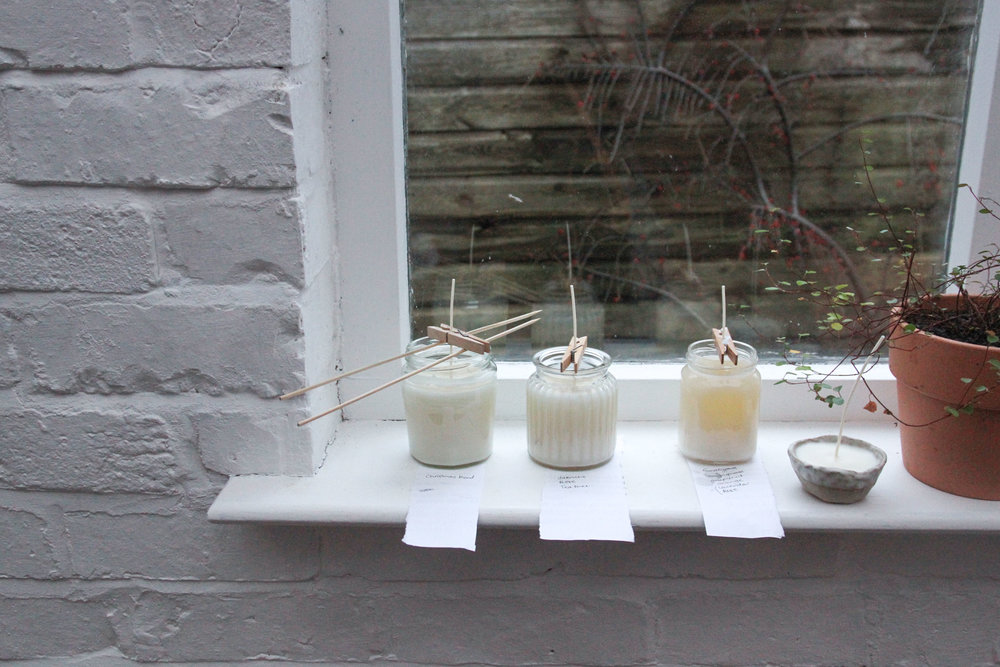 Homemade soy candles  in a recycled jam jars