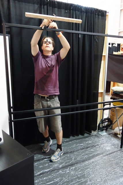 Benoit fitting lighting to powder coated steel frames. He was responsible for all display & booth design.