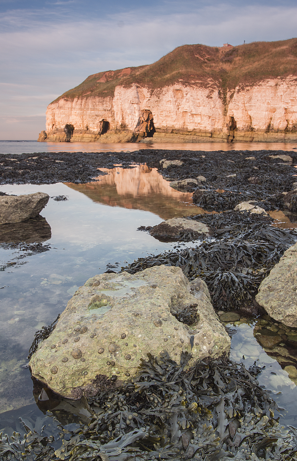 Evening light and reflections at Thornwick bay