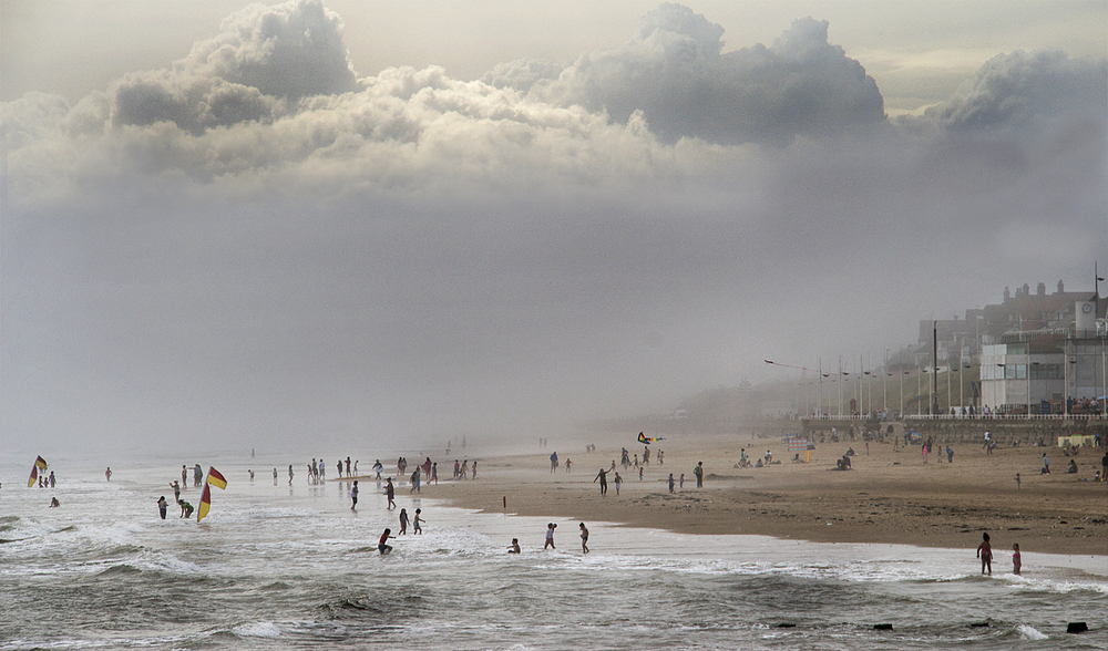 Sea mist and storm cloud surrounding the beach