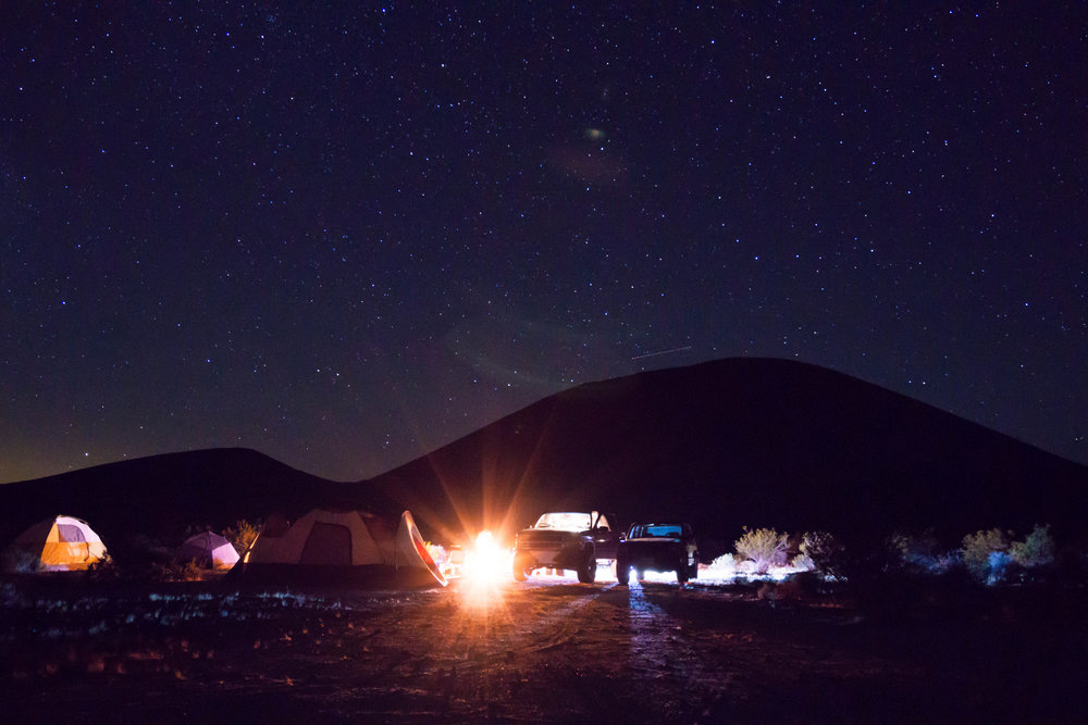 With camp set at the base of a dormant volcano we gather around the campfire, joking & story-telling through the wee hours of the night.