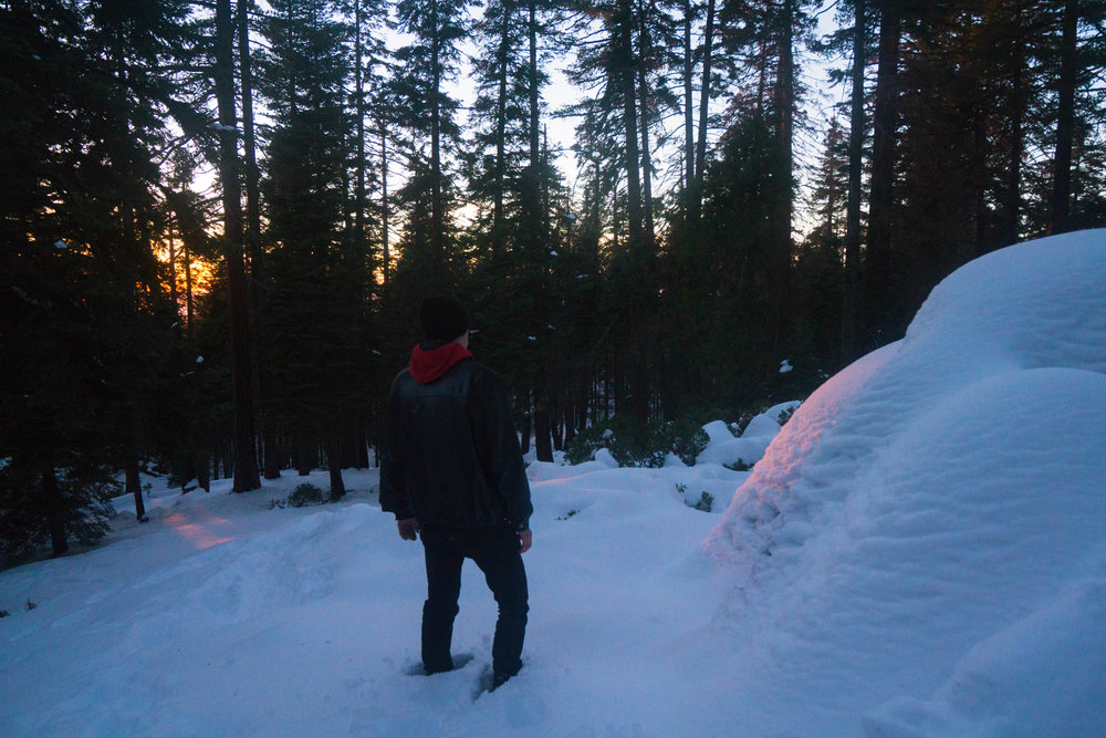 With camp now fully set up, we wander off to watch the last light diminish as the powdery snow glows a ruby red.
