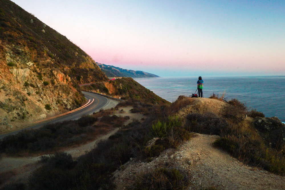 Dylan snapping away pictures of his own high above PCH.