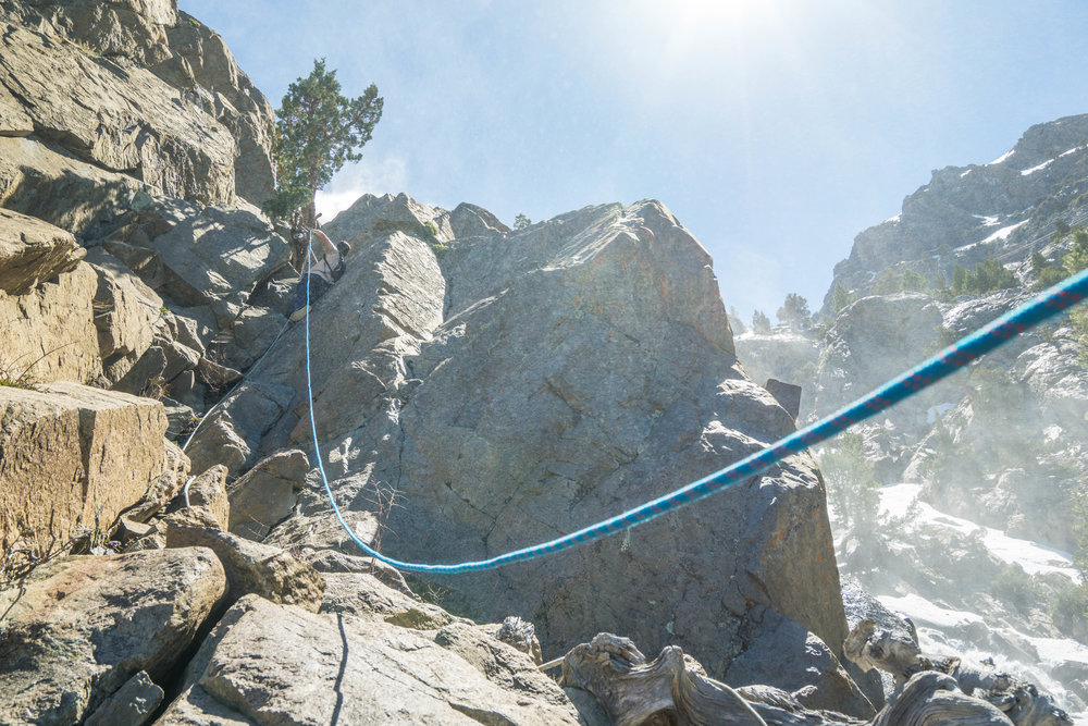 To proceed we had to navigate a vertical section of granite with a conveniently placed rope. Shoutout to whoever climbed this unaided to secure the rope!