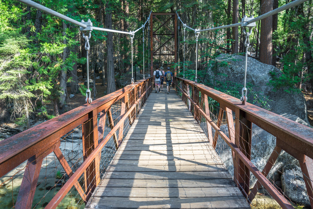 Deciding to dry off & do some terrestrial exploring, we cross a rusty historic bridge further into the canyon towards a magnificent meadow.