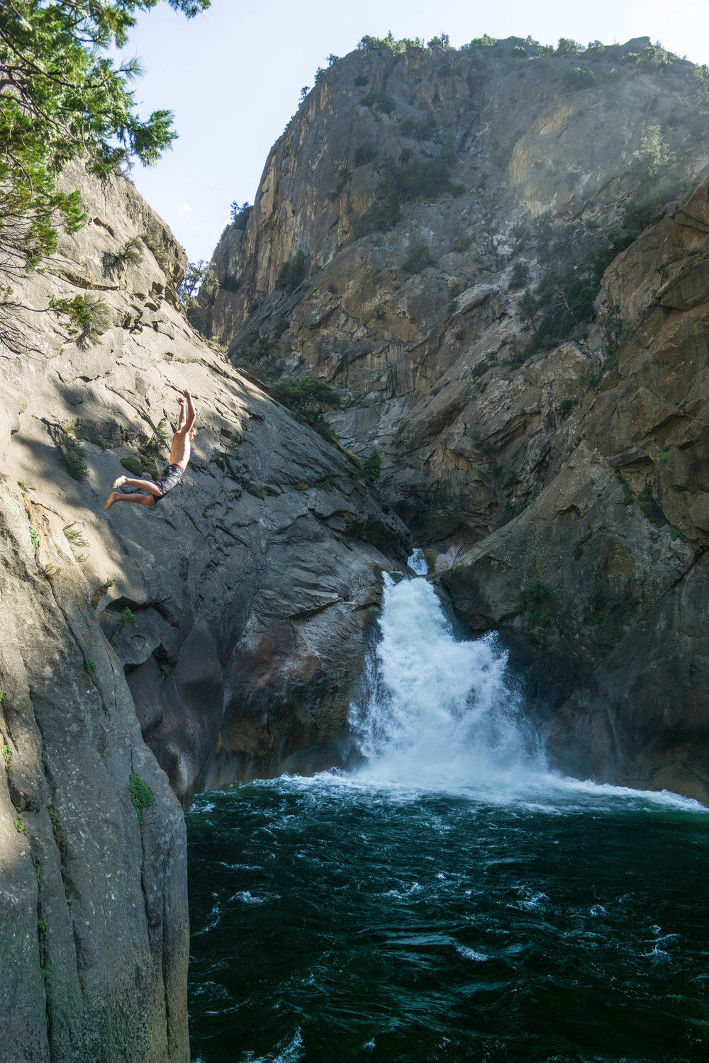 Jump after jump, we leap into the icy waters amid the torrent sound of the falls.