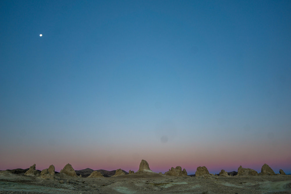 Pre-sunrise creates an alien world. A soft pink band hugs the skyline of ancient sea towers.