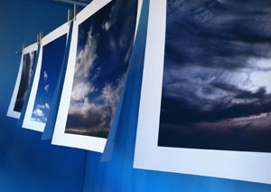 Paper clouds, hanging on a line in a Pt Townsend, WA store window. Just for fun, and because Pt. Townsend can always use a few more blue skies too.