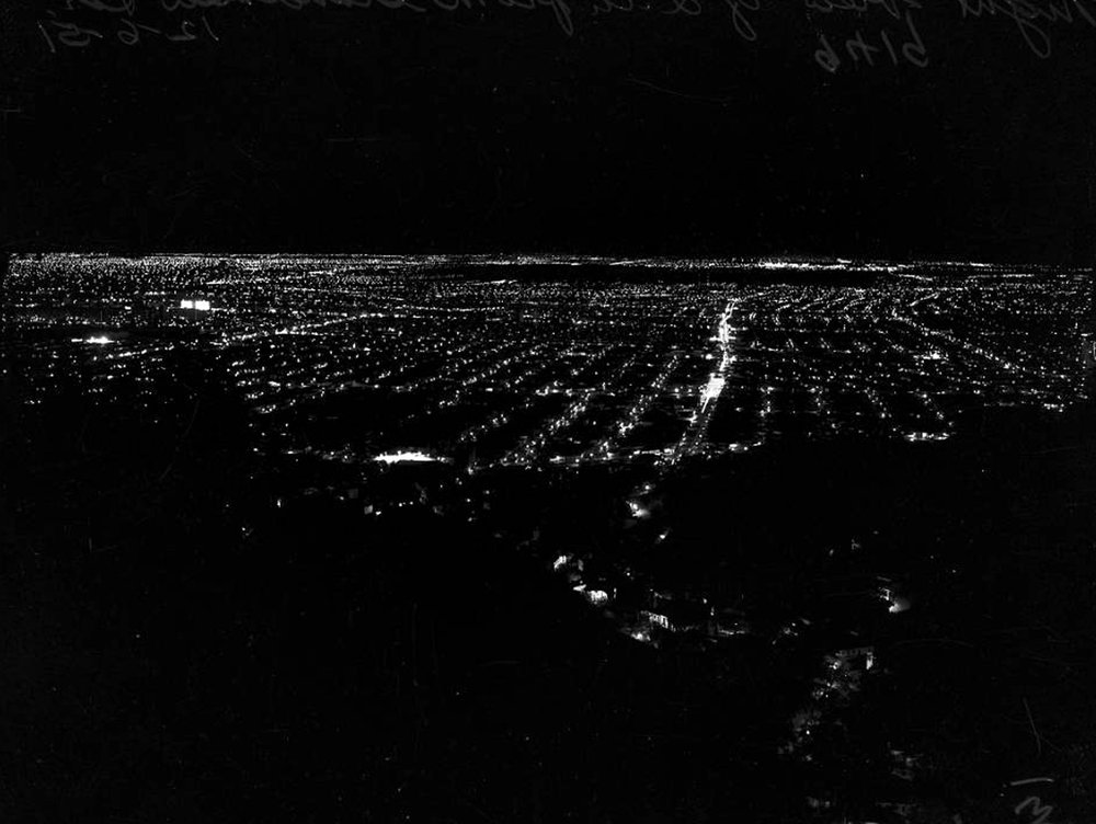 Los Angeles from Grandview Drive, 1951.  Seen from the hills above Laurel Canyon Boulevard, the street grid of mid-century Los Angeles glows. Photograph courtesy of Los Angeles Examiner Collection, USC Libraries