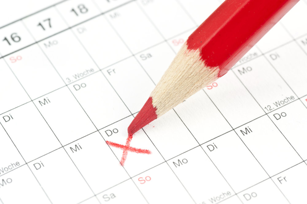 Red pencil marking an X on a calendar