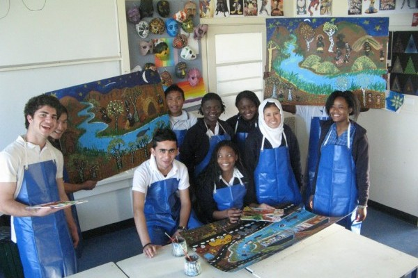 Students with their work in the school's Art room