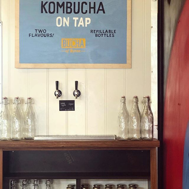 #Repost @baygrocer ・・・ Tucked away in the corner under the pretty art work by @paulmcneilart is our kombucha on tap proudly brought to you by @thebuchaofbyron - both the original and lemon myrtle in fill your own 1 litre bottles. Swing by and Bucha up for the weekend #kombucha #grocer #byronslocalfoodstore #byronbay