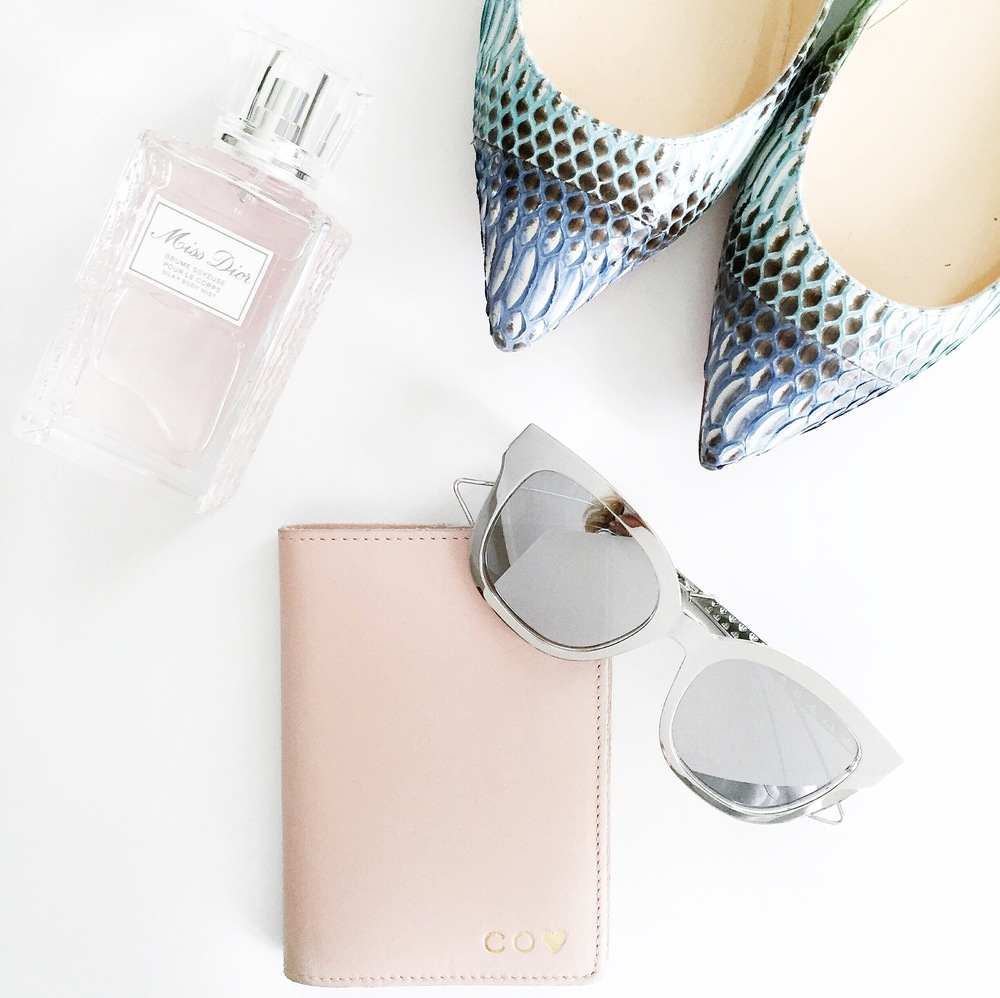 Perfume: Christian Dior Sunglasses: Christian Dior Shoes: Christian Louboutin Passport cover: Cuyana