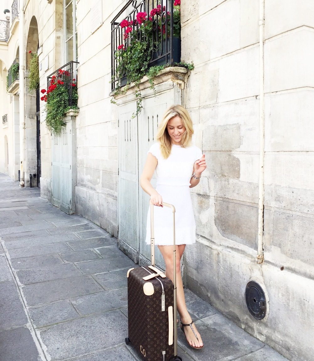Dress:  Zara  Luggage:  Louis Vuitton Rolling Luggage  by Marc Newson Sandals: Similar styles from  Sam Edelman