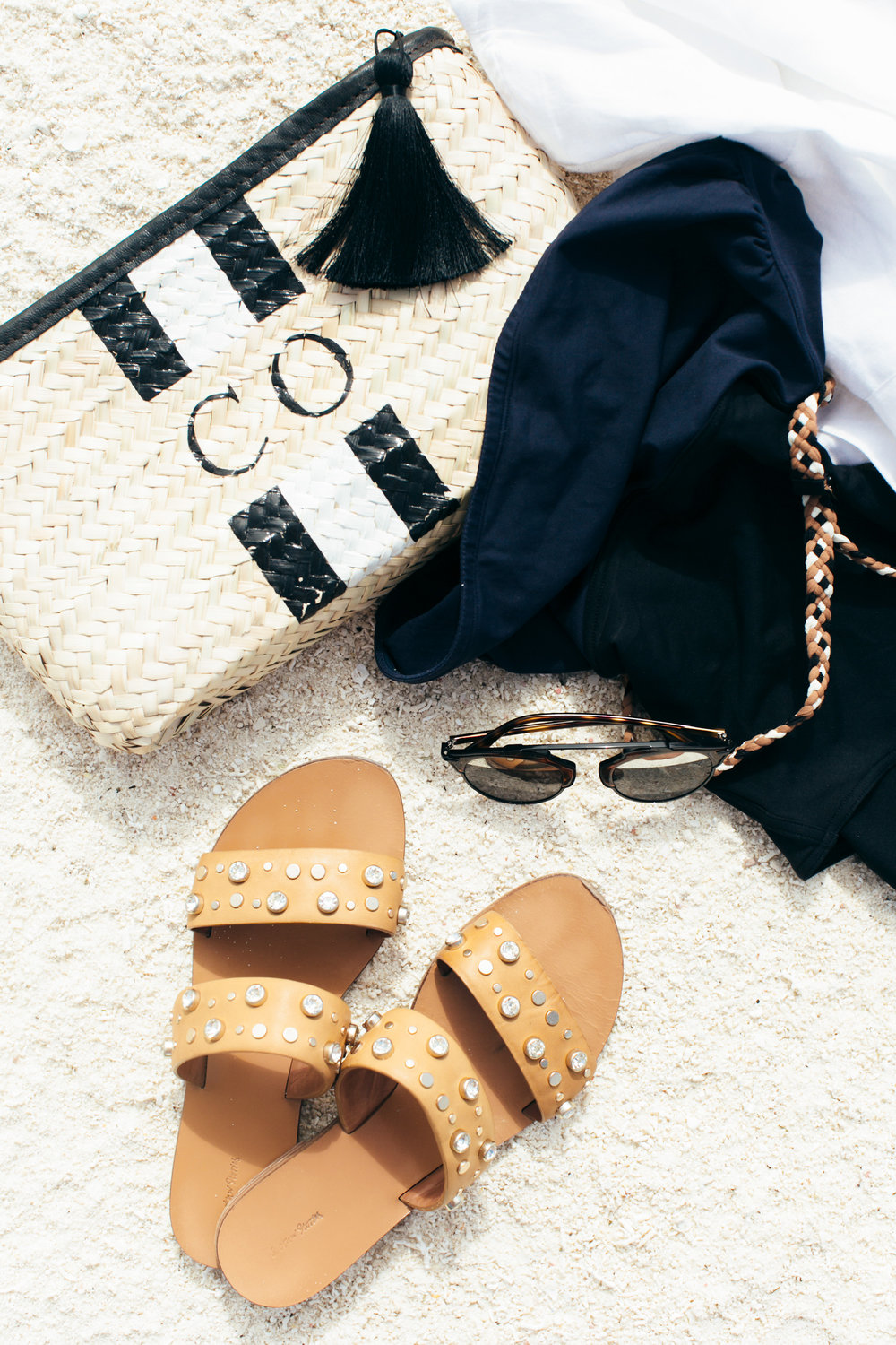 Swimsuit:  ERES  Bag:  Rae Feather  Shoes:  & Other Stories  Sunglasses:  Dior    Shirt dress:  GAP
