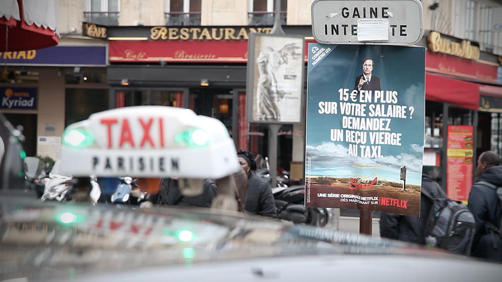 """Get a 15€ bonus next month. Get a blank taxi receipt today.""  Taxi station at 40 Saint-Quentin st, Paris"