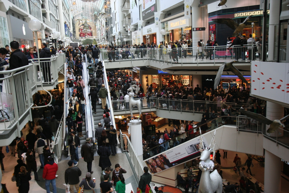 Boxing Day crowds shopping at the Toronto Eaton Centre in Canada, 2007 by Skeezix1000 via Wikipedia