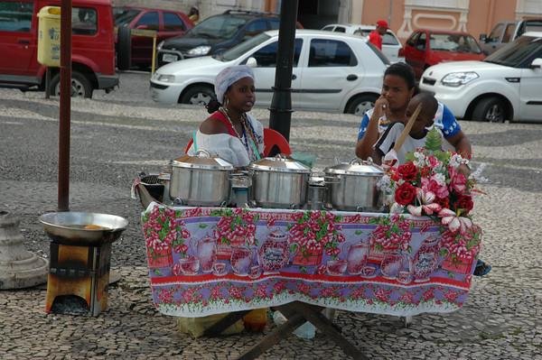 Two Brazilian women selling food