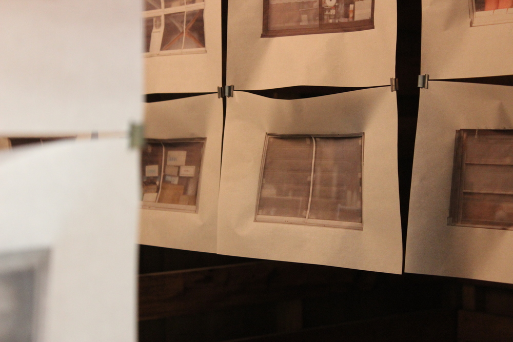 Photographs of buildings windows printed on tracing paper.