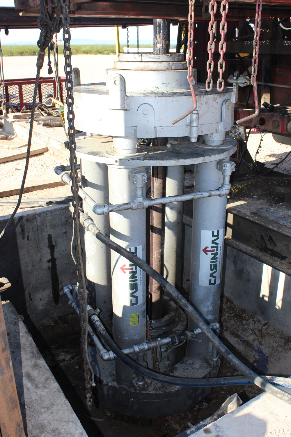 Casinjac Model 500 casing jack mounted on flange in cellar. This jack is rated at 1,000,000 lbs. and was holding 880,000 lbs. when the photo was taken.
