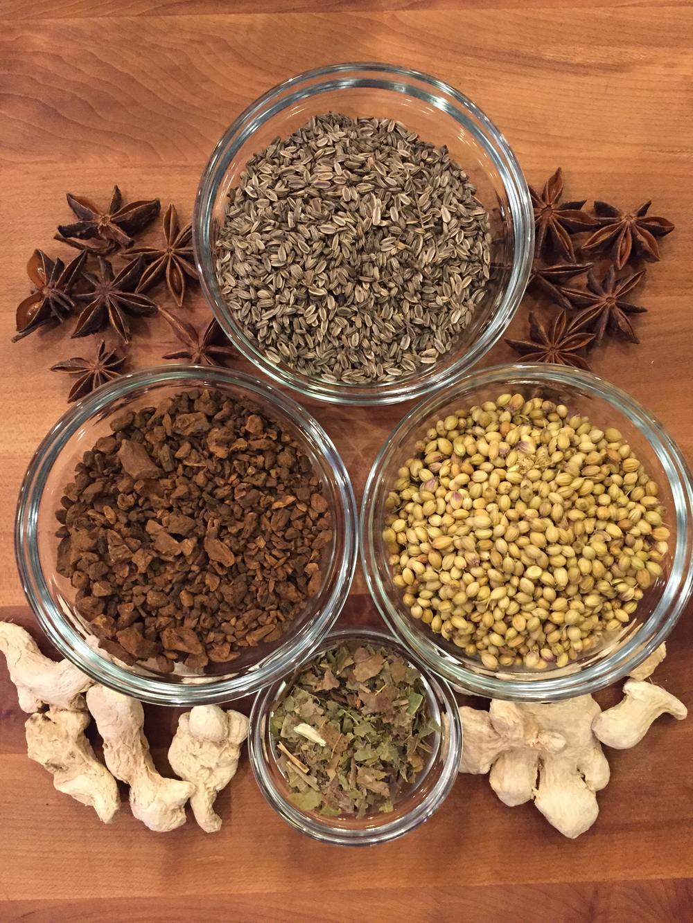 Almost all of the above can be sourced locally. In the bowls, from top, clockwise: black fennel seed, coriander seed, black walnut leaves, and chicory root. On the board, from top, star anise and dehydrated ginger.