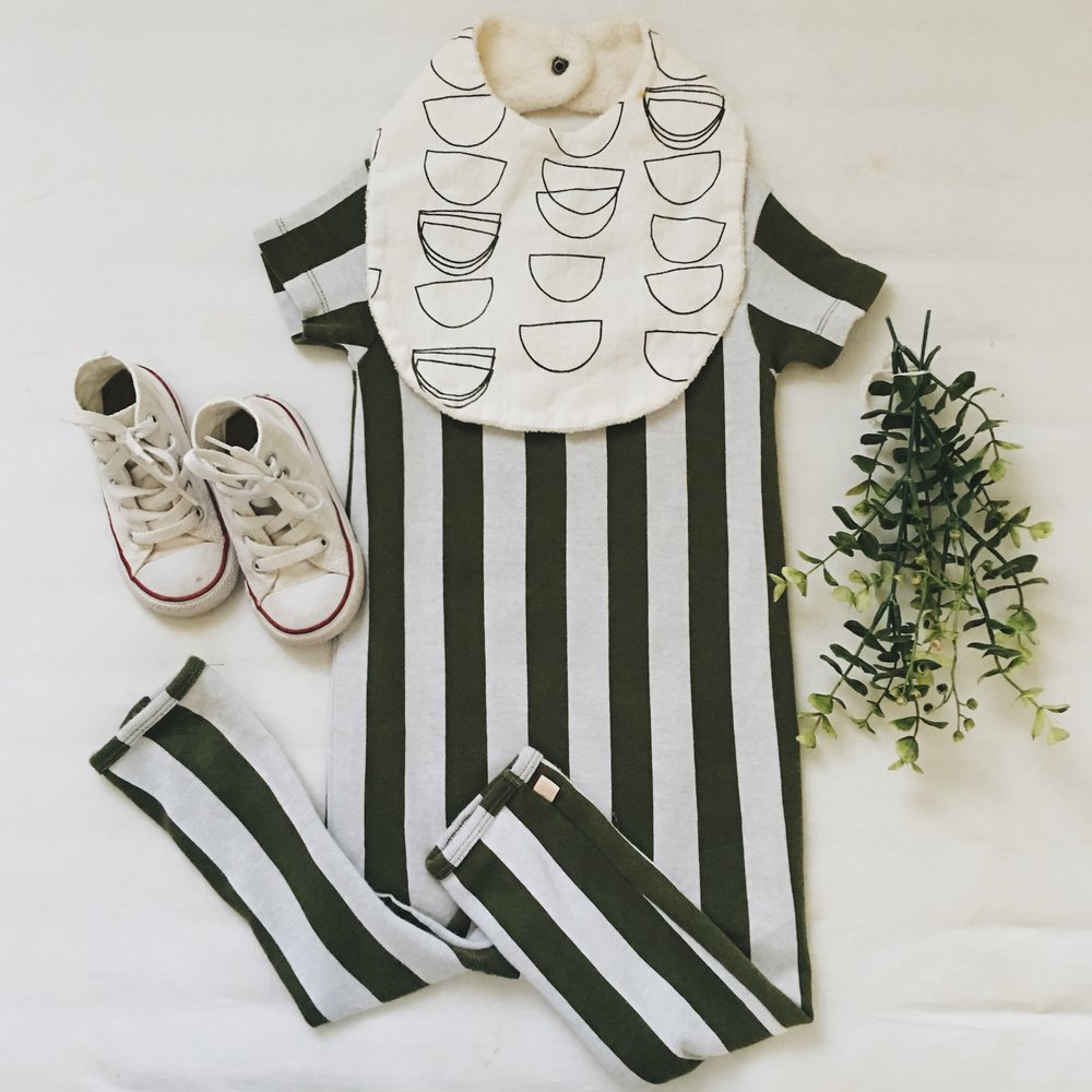 Romper - Tiny Cottons c/o Murray & Finn ; Bib - Wild Winnie ; Sneakers - Converse