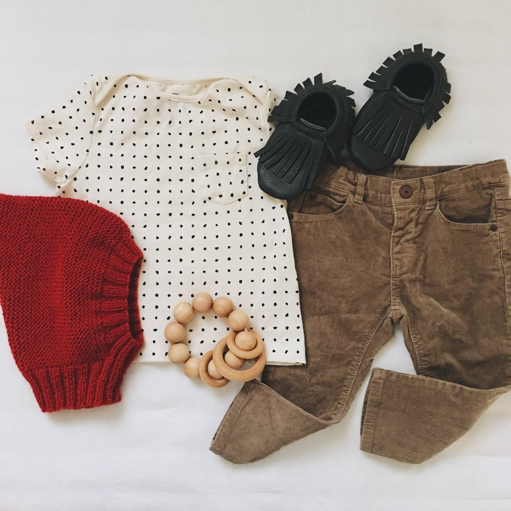 Dot Tee - Petite Soul Shop ; Corduroy Pants - Zara ; Knit Gnome Good - Under A Tin Roof ; Raven Moccasins c/o Little Pine Outfitters ; Round Rattle Teether c/o Wild Creek Co