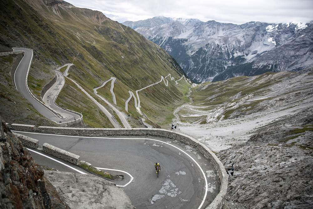 Mike Climbing The Stelvio Pass, a mountain pass in northern Italy, elevation of 9,045 ft. It is the highest paved mountain pass in the Eastern Alps, and the second highest in the Alps, just 43 ft below France's Col de l'Iseran (9,088 ft).