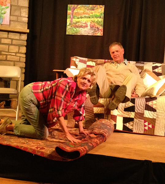 Ethel (Charlotte Keefe) and Norman (Lee Imboden) unroll a rug as they prep the lake house for the summer.
