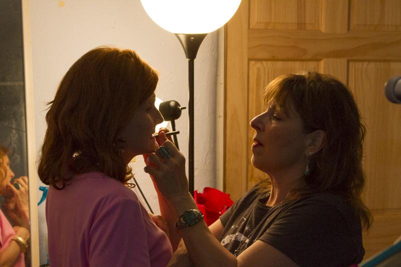 Anna gives Julie a few touch-ups.