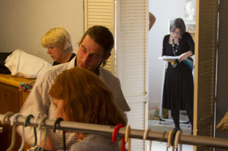 Jarrod gives an opinion on Julie's costume prep, while Sheryll (stage manager) frets over prop placement. The director (Judy Kasper) gives a last minute direction.