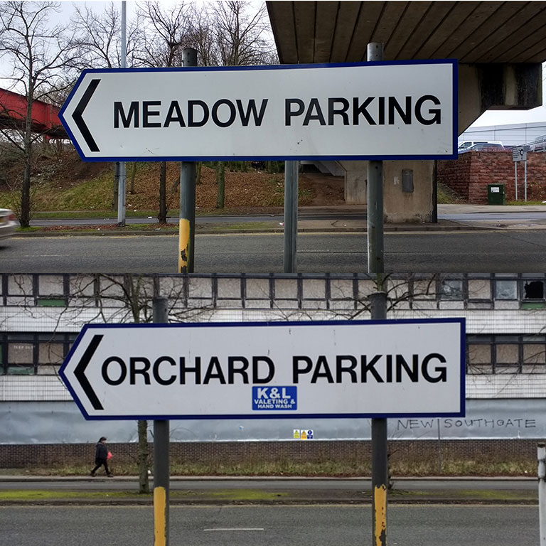 BEFORE: Signage to carparks that don't exist anymore