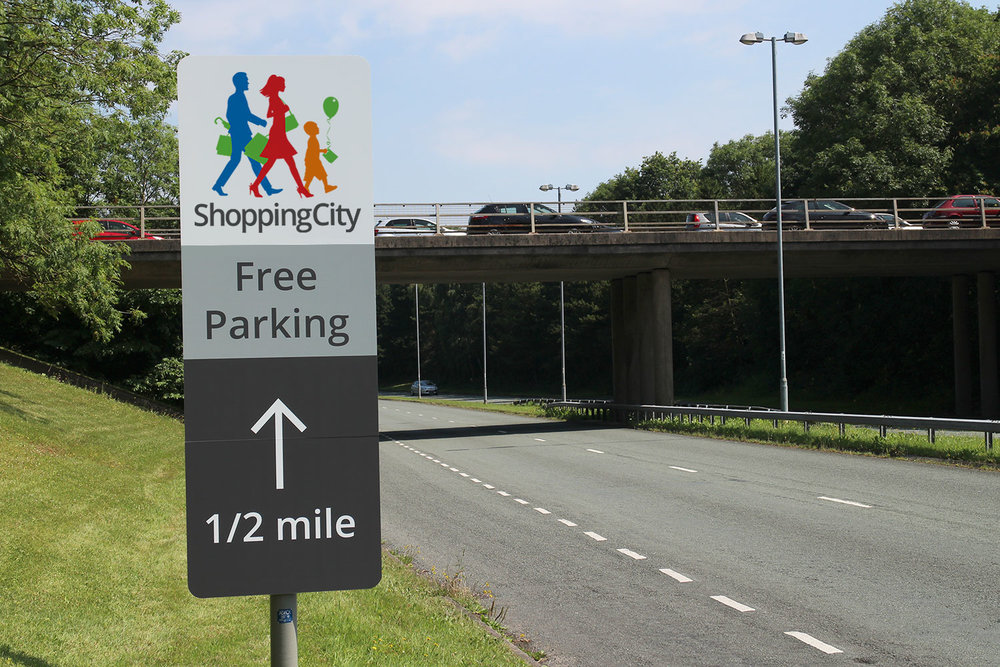 Road signage is now clean and clear, says shopping at a glance and communicates free parking
