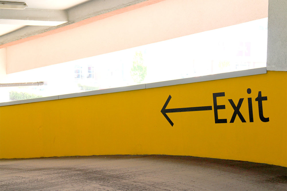 Exit and other functional design elements use yellow across all carparks