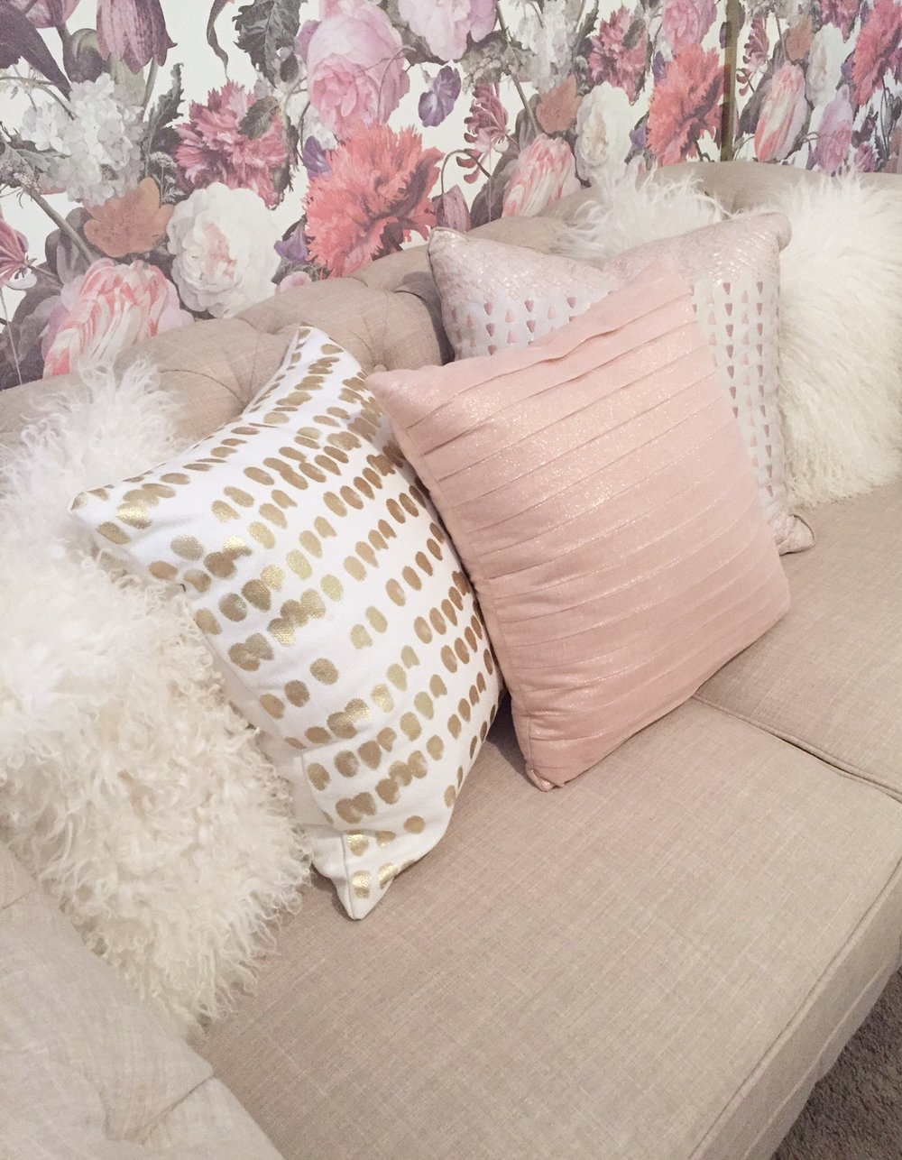 Assorted pillows make the settee the perfect place to sit.