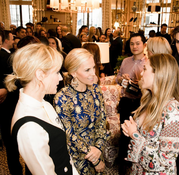 Tory Burch with guests at her London opening