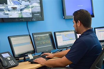 Jaguar Employee with Security and Monitors