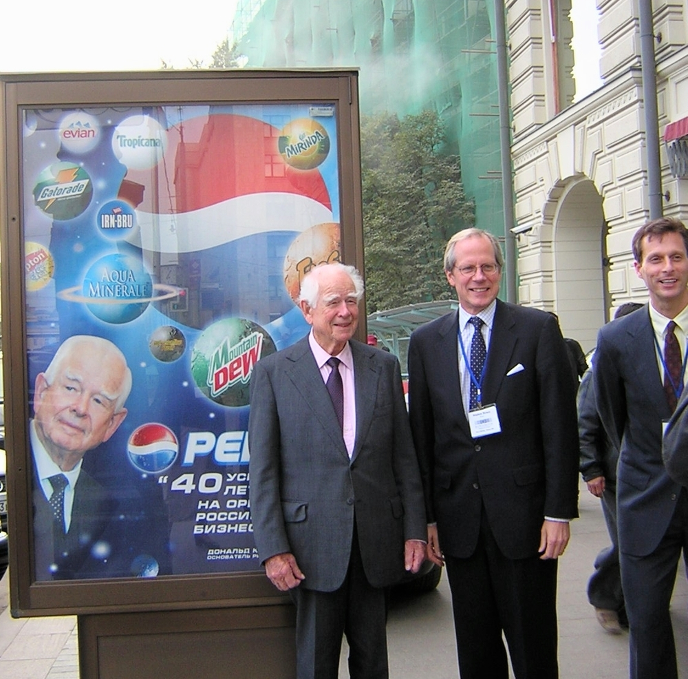 Don Kendall, who brought Pepsi to the Soviet Union, Stephen Heintz of the Rocfeller Brothers Fund and I in front of the National Hotel on Red Square during a break in a meeting of the board of the EastWest Institute in September 2003.