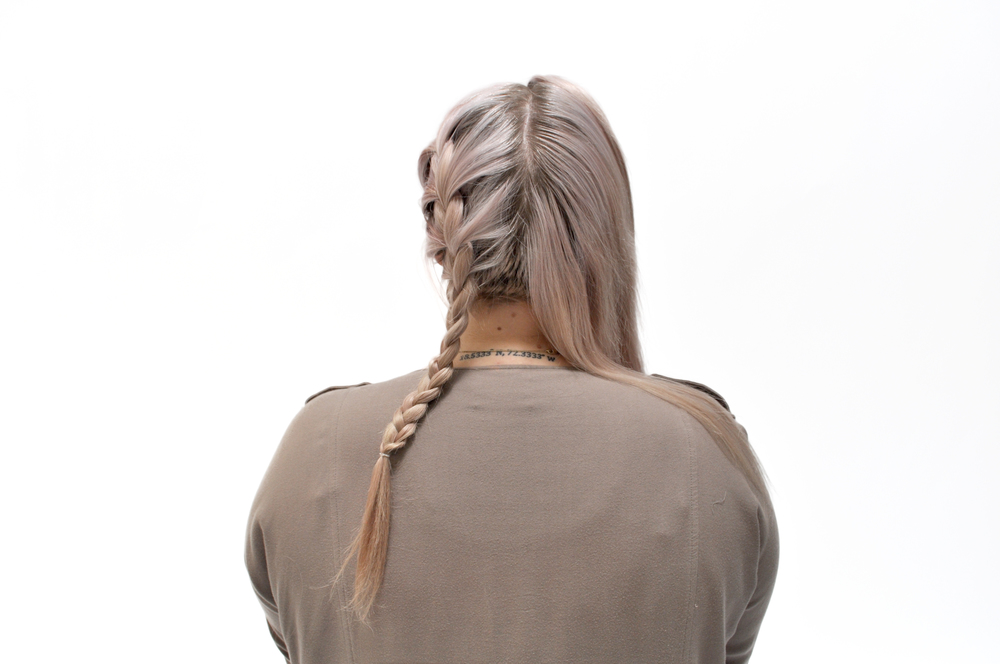 Start braiding. As you switch the strands from side to side, gather small sections from your head into the strands you have braided as you go down, making sure to keep them tight and neat.