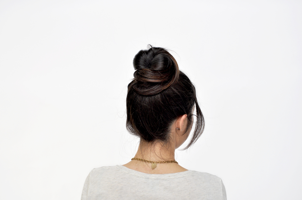 Tease out some strands of the bun to add more volume to the bun. Finished. You a #bunboss now.