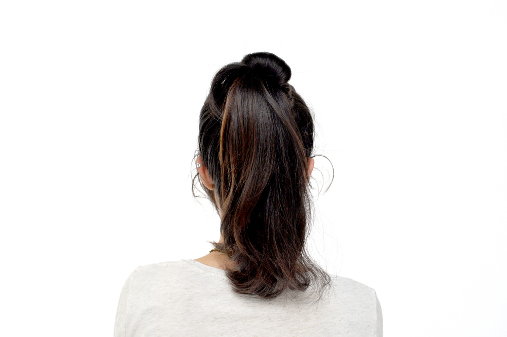 Take one section of your pony tail and wrap it around the base. For a messier effect, loosely wrap the section around the base and secure the end with a bobby pin.