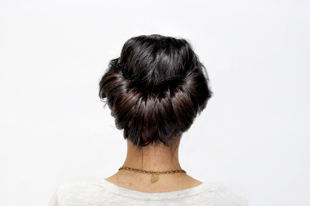 With the rest of your hair that is meeting in the middle, roll it into the headband. If your hair is longer, you will have to roll it in once or twice. Secure the ends inside the roll with bobby pins.