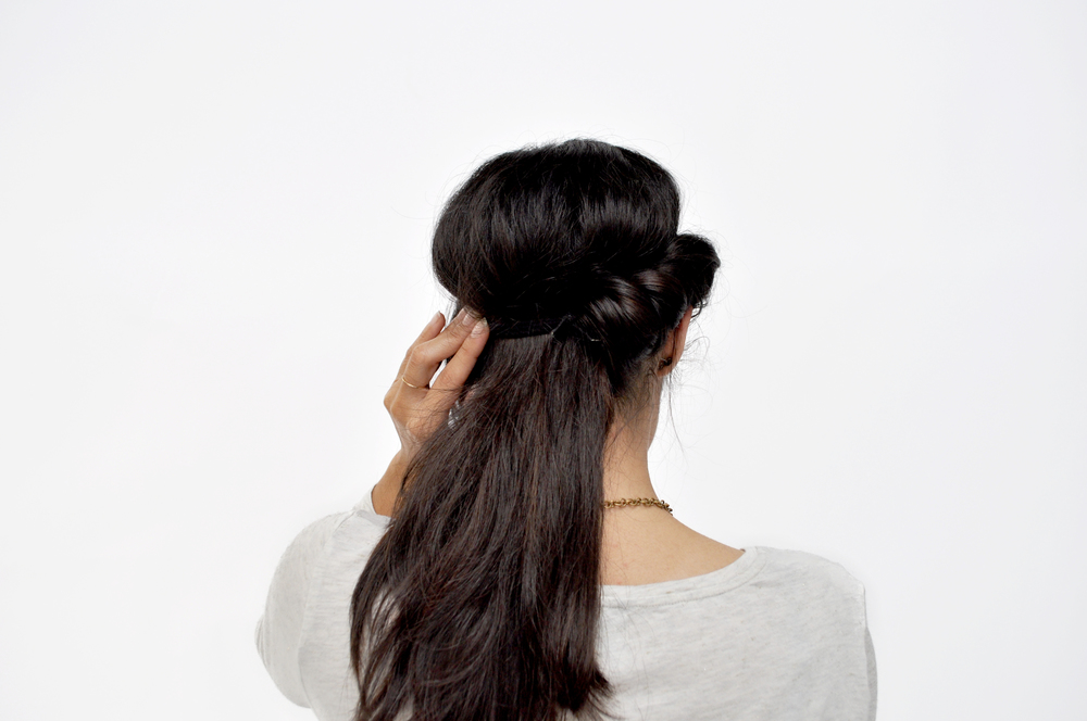 On one side of your hair, start tucking in your hair through the headband, and continue rolling until you get to the end. Repeat on the other side.