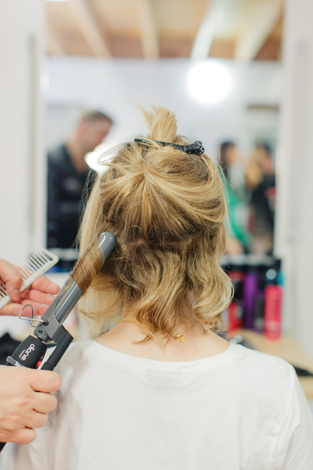 Begin sectioning off your hair and apply  Matrix StyleLink Heat Buffer  before you begin curling.