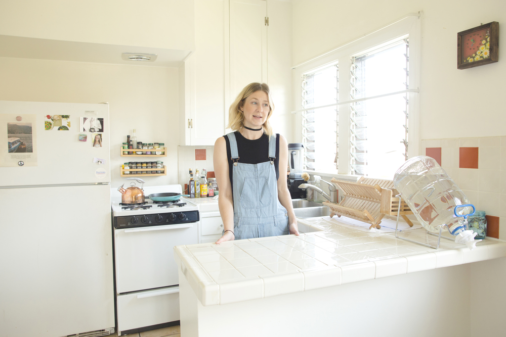 The place where it all started. To her left, a zero-waste alkaline glass water jug.