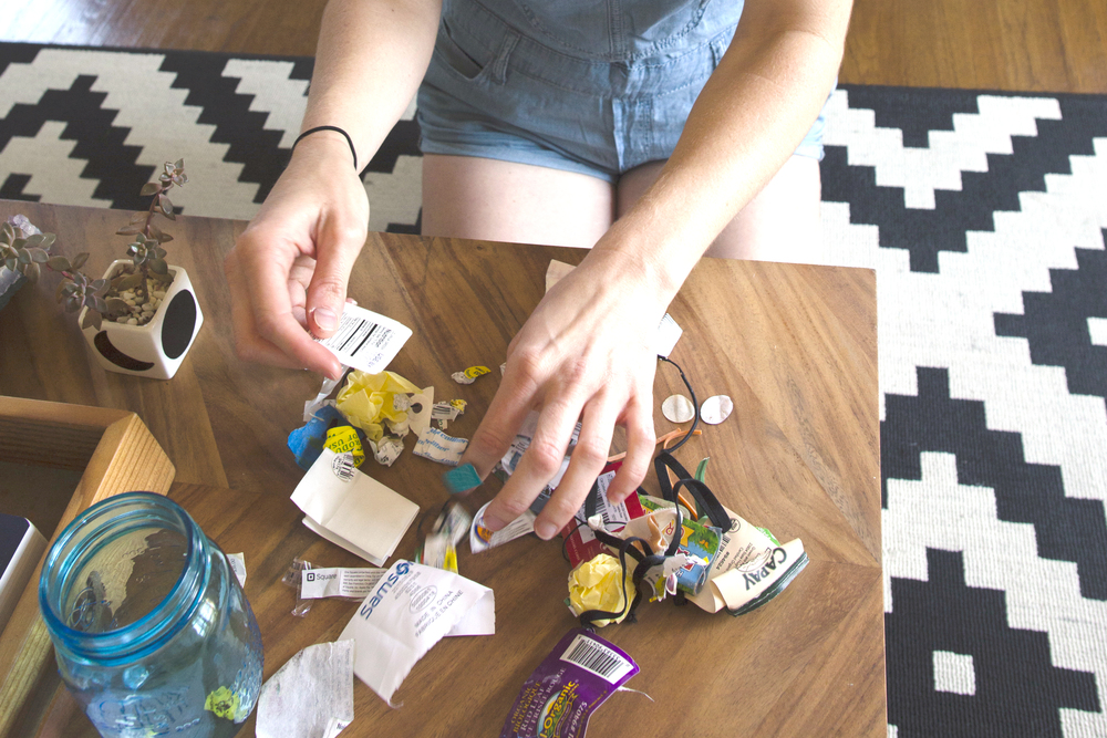 """This is my trash from the past three months!"" she exclaims. ""I'll keep it and I'll analyze it. I like to keep it because then I can go through it and find a solution. We don't have a relationship to trash.  People just don't know where it's going-- someone picks it up, takes it away, so how are you supposed to care when you don't see it?""   Photo by Matthew Romasanta"